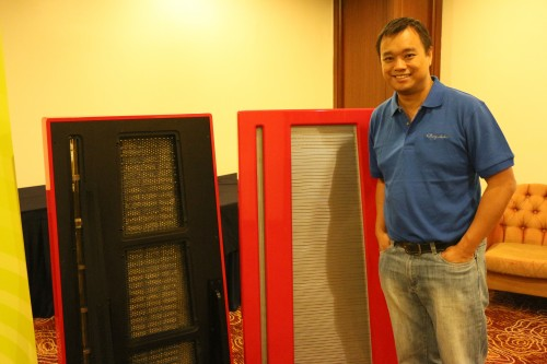 CEO of Clarisys Audio Pte Ltd Kurt Wee posing next to his Clarisys speakers.