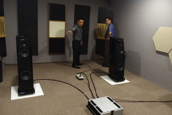 Eugene Ngoh and an audiophile in the smaller listening roo featuring Rockport speakers and Vitus amps.